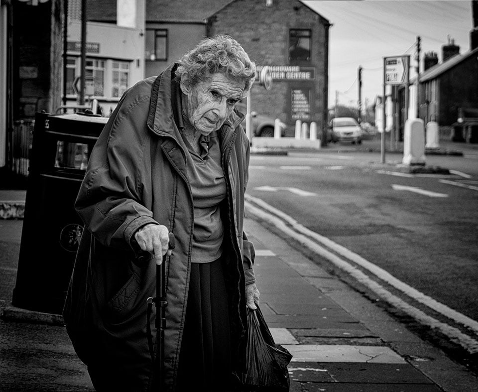 Old woman shopping, Seahouses UK 2016